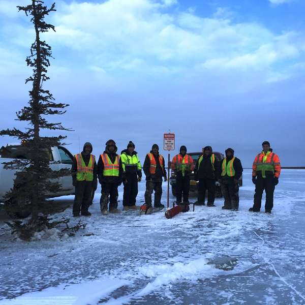 Lower Kalskag, Napaimute, & Crow Village Crew at Mile Post 0 of Upriver Route 1 near the mouth of the Tuluksak River
