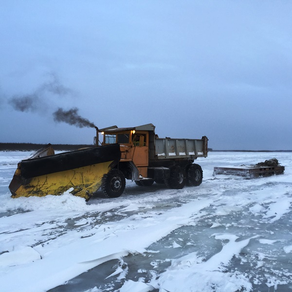 50 year old plow truck dragging steel flats to knock down the rough ice between Tuluksak & Kalskag